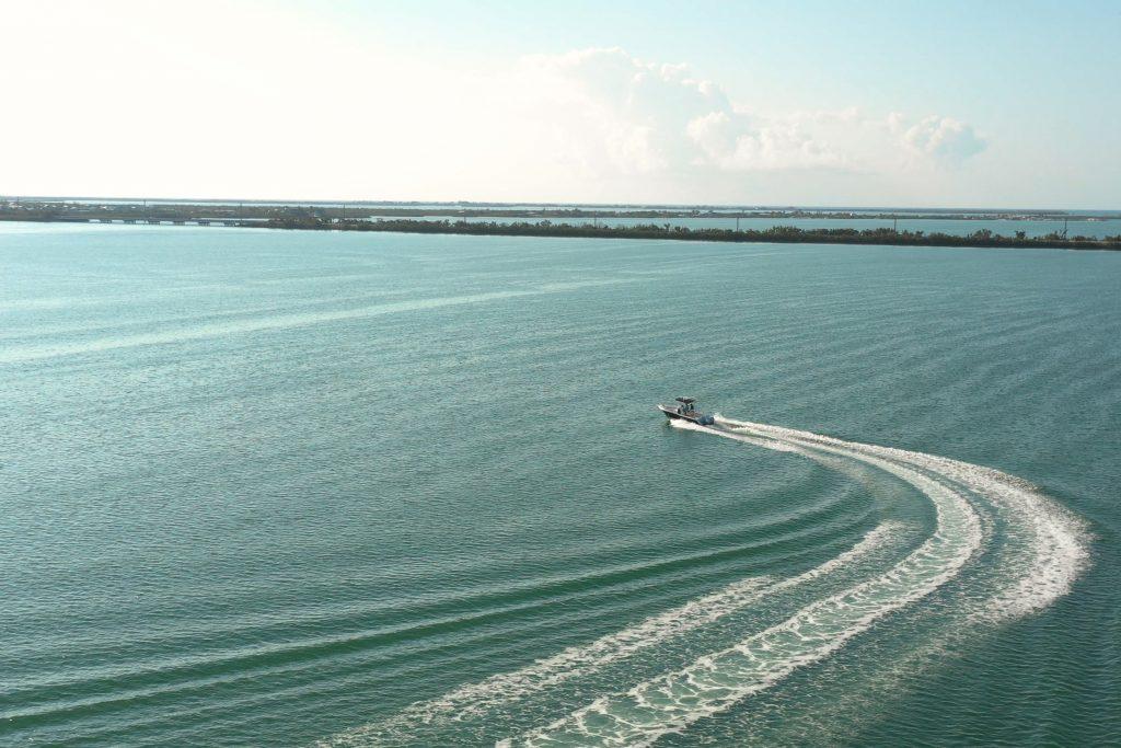 A sportfishing boat cruising through the bay in Key West, FL