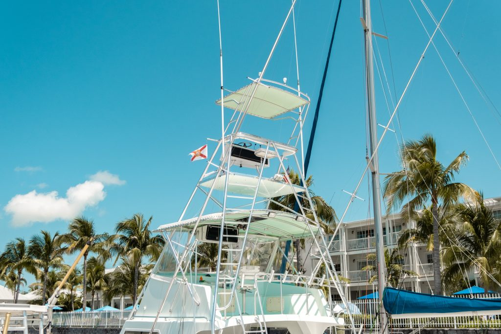A large charter fishing boat in Key West, with US and Florida flags flying from its tower