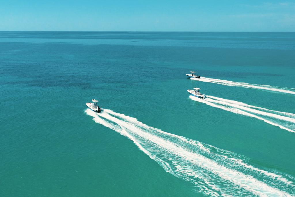 Three boats speeding offshore in the Florida Keys