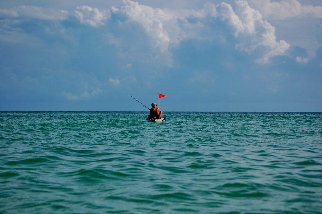 A man kayak fishing in Key West