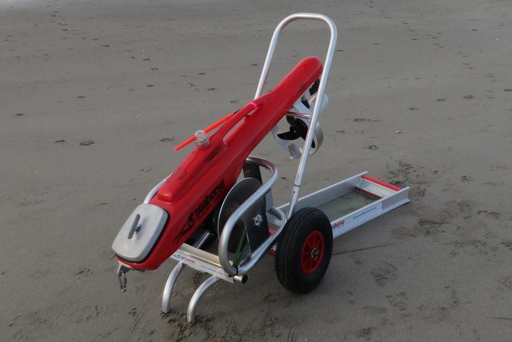A complete kontiki fishing setup on a trolley on a beach
