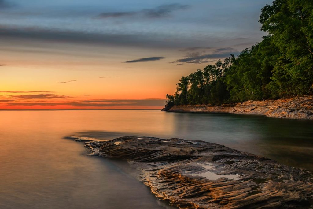 A view of Lake Michigan's shoreline at sunset.