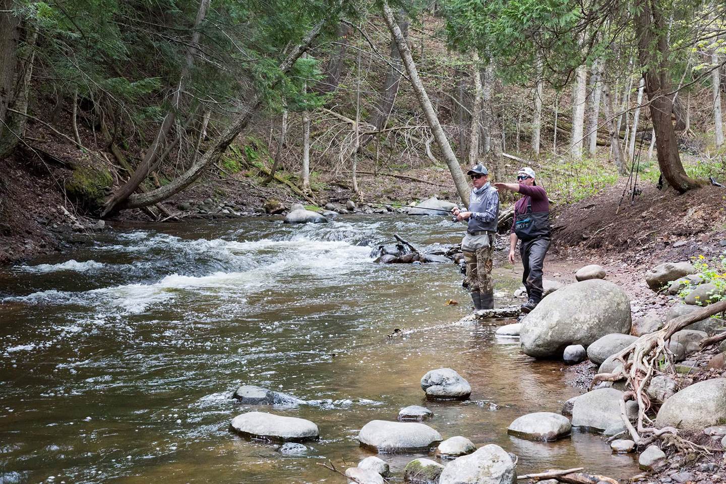 A veteran being taught how to fly fish at a fishing therapy session