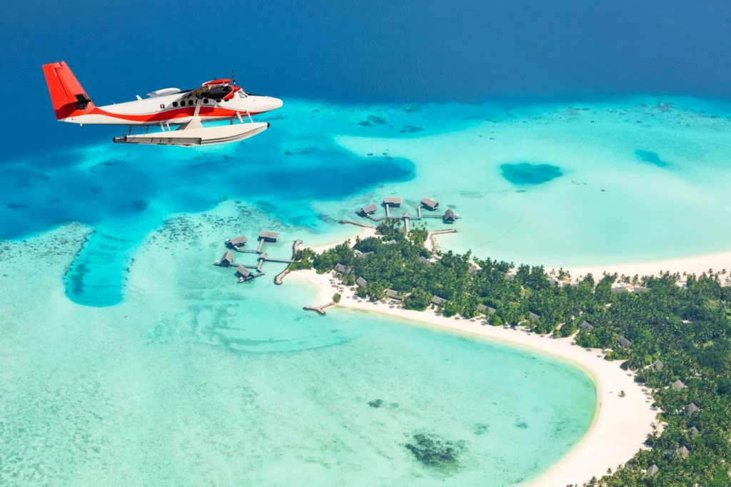 A seaplane flying over one of thousands of islands in the Maldives.