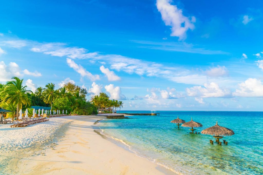 A beautiful island in Maldives with white sandy beaches and clear waters.