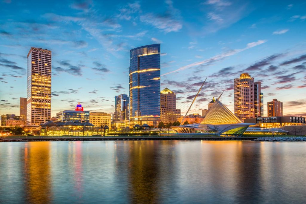 A view of Milwaukee's city skyline at dusk, with Lake Michigan in the foreground