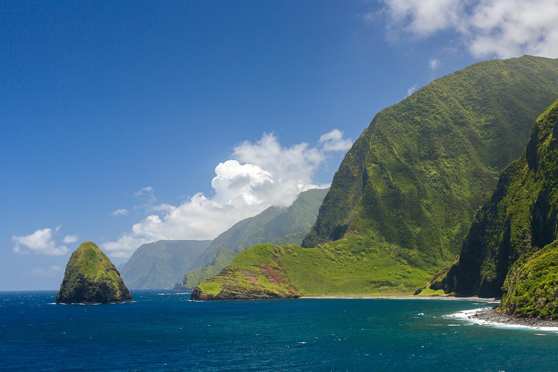 High green cliffs and deep blue sea on the small Hawaiian island of Molokai.