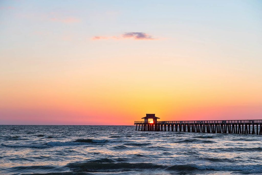 The sun sets on a fishing pier in Naples along the USA's Gulf Coast