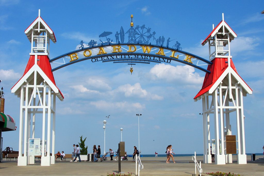 A large wooden arch on the boardwalk in Ocean City, Maryland