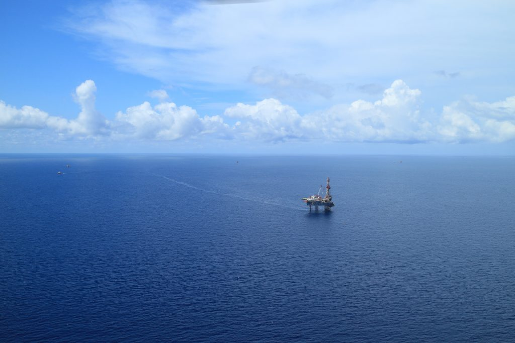 An aerial view of a remote offshore oil rig