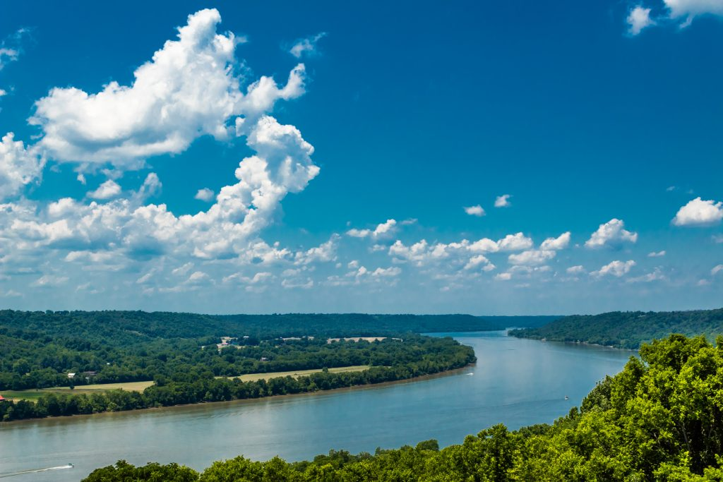 A bend on the Ohio River, with green forest on either side