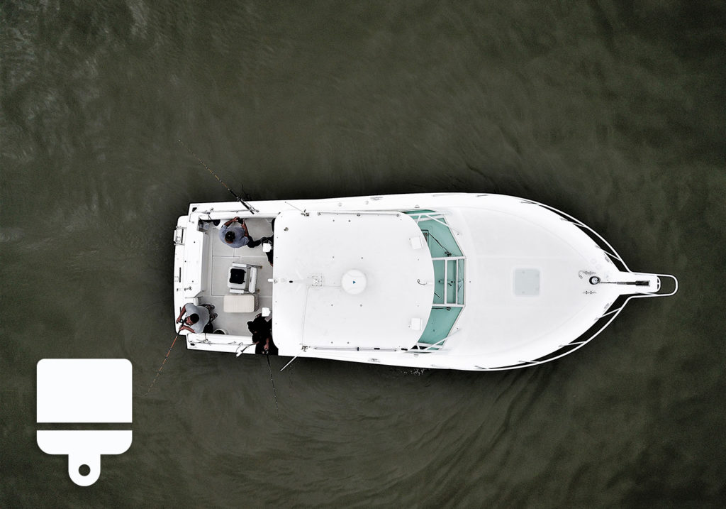 A bird's view of a boat with an icon of a painting brush in the bottom left corner