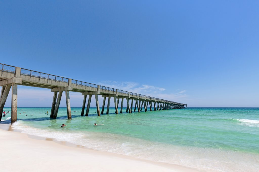 Pensacola Beach Gulf Fishing Pier stretching into the sea, as seen from the beach