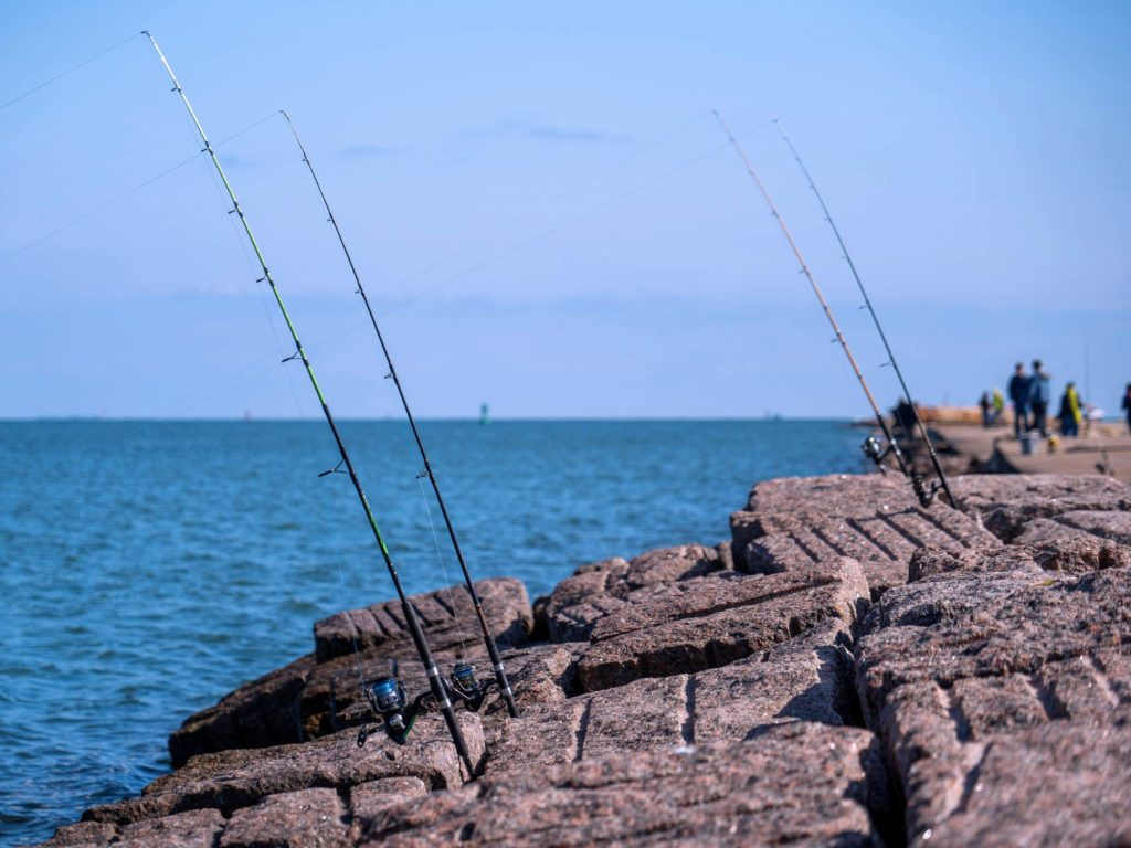 Fishing rods jammed into the rocks of a pier in Texas