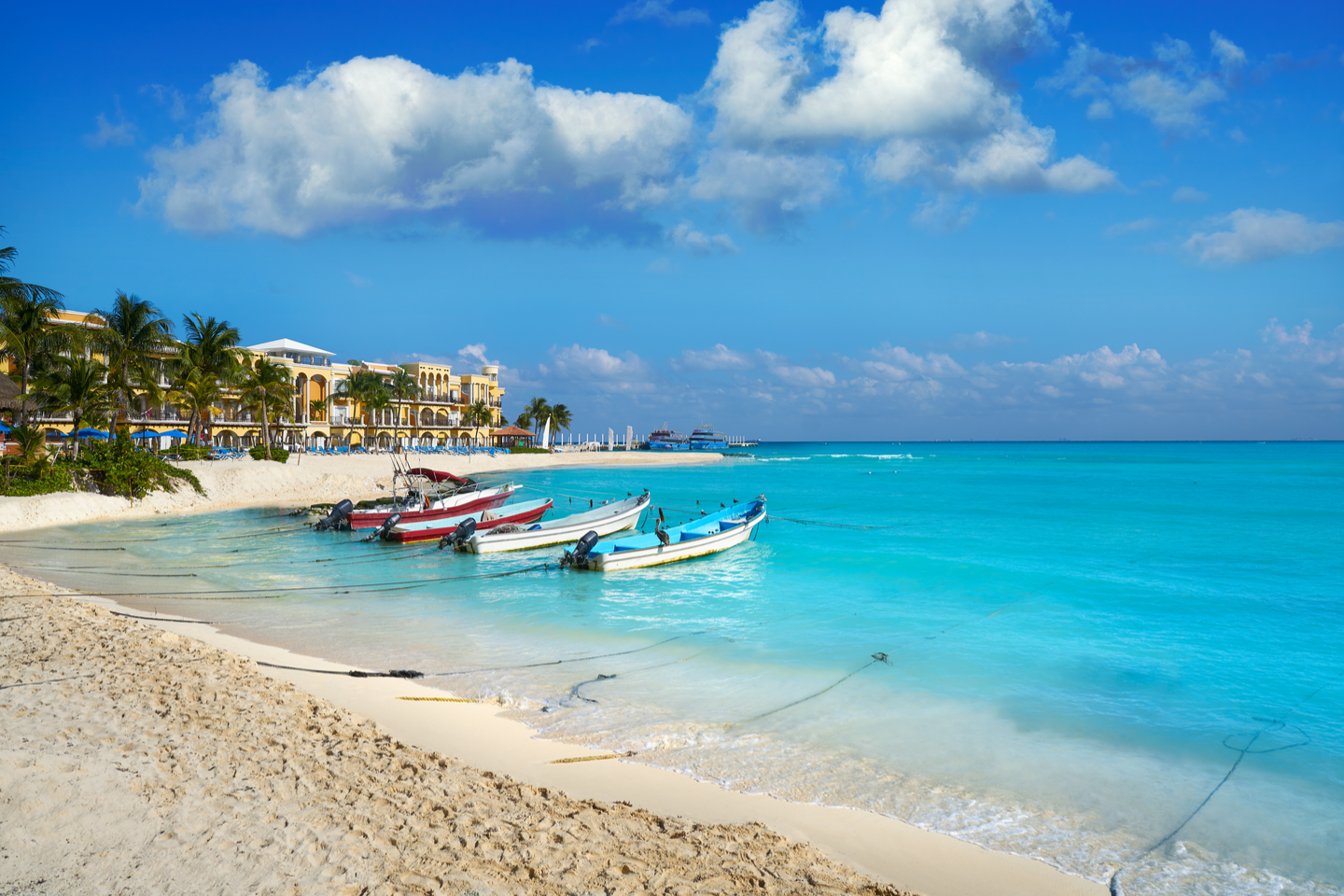 boats looking out to the sea from the Playa Del Carmen beach