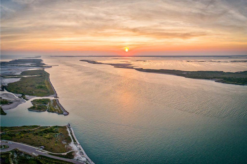 An aerial view of Port Aransas, Texas, at sunset