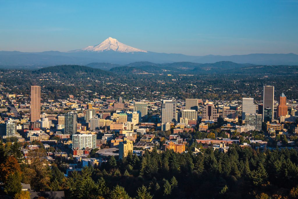 Portland, Oregon seen from a distance, with Mount Hood rising in the distance