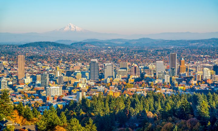 An aerial view of Portland, Oregon with mountains in the distance