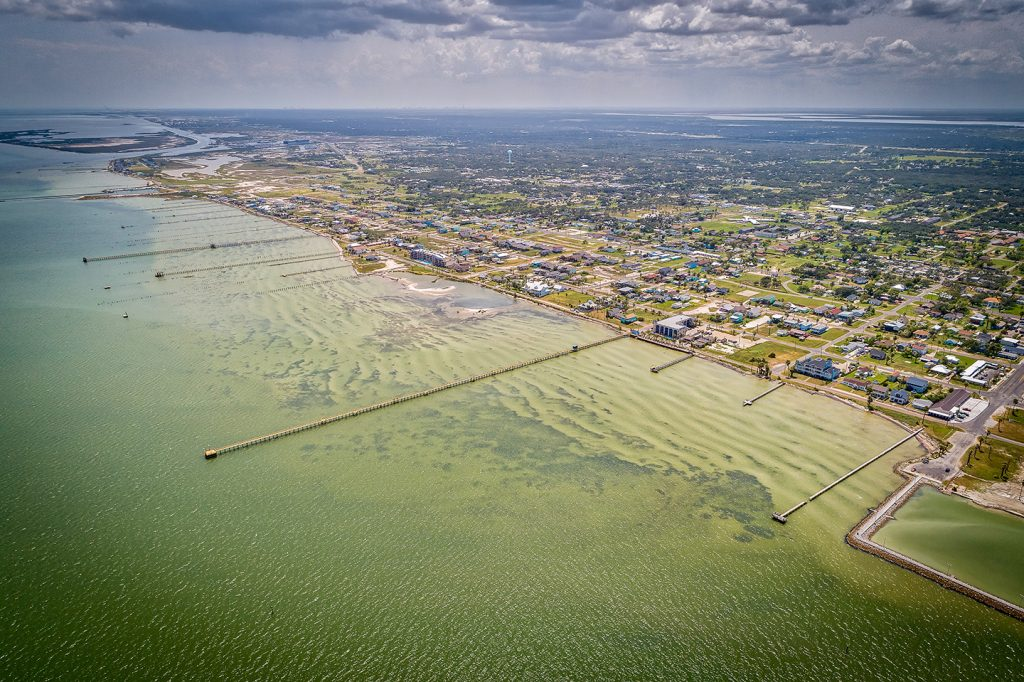 An aerial view of Rockport, Texas, with lots of fishing piers stretching into the water
