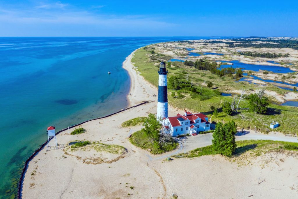 An aerial view of Big Sable Point Lighthouse, located on Lake Michigan's shoreline.