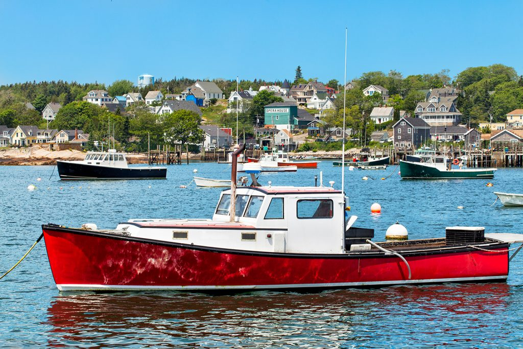 Classic Downeast lobster fishing boats in the harbor in Stonington, Maine, one of the most unspoiled fishing towns in the US.
