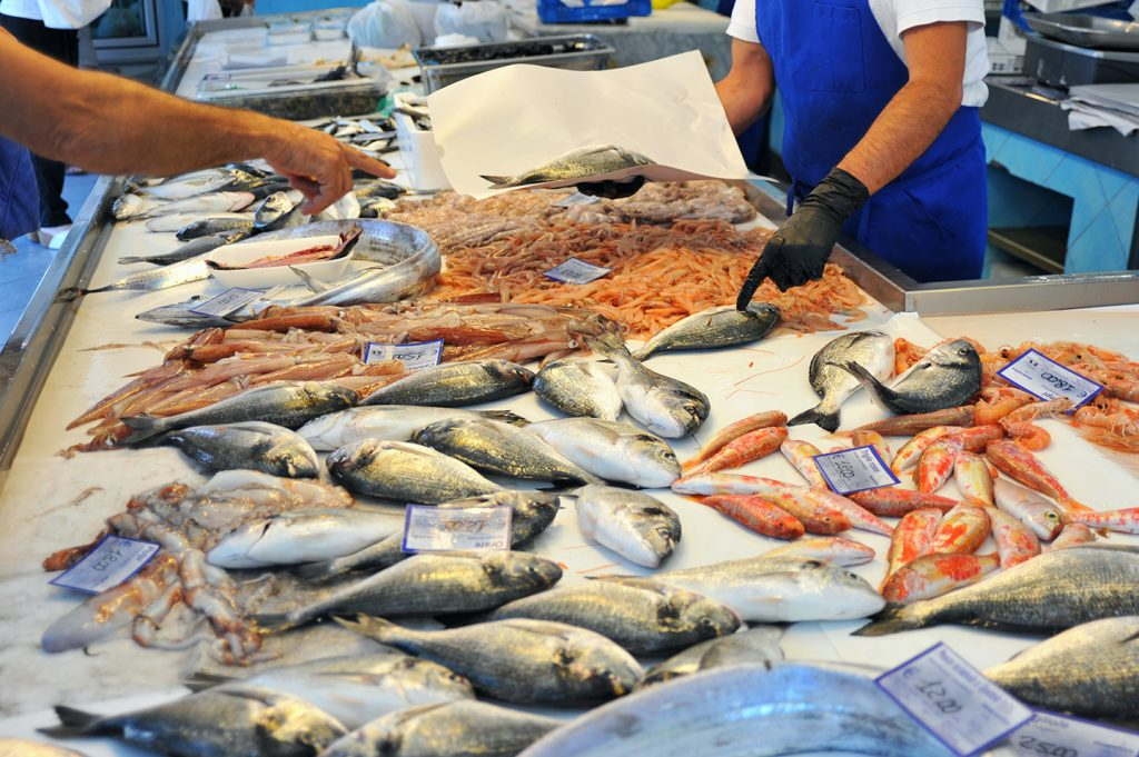 A selection of different fish in a fish market. Markets are one of the best places to find sustainable fish.