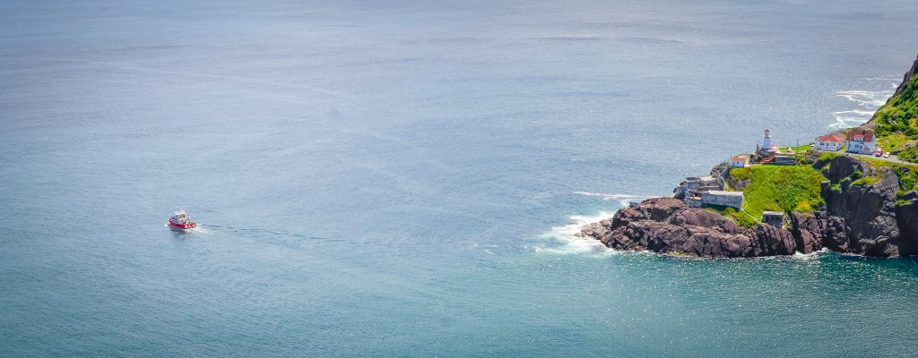 A view of a boat going offshore from the coast of Newfoundland
