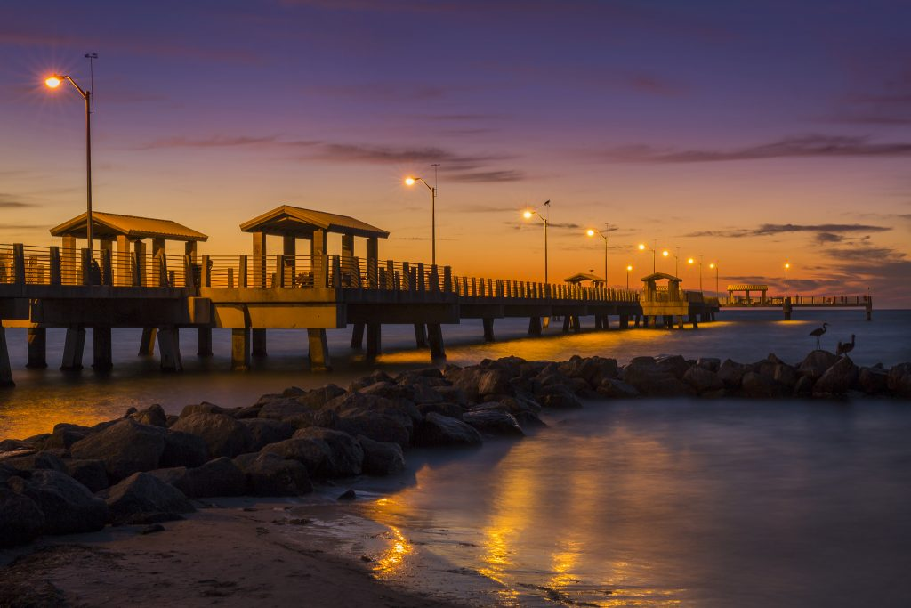 A view of a pier in St. Petersburg, FL during sunset
