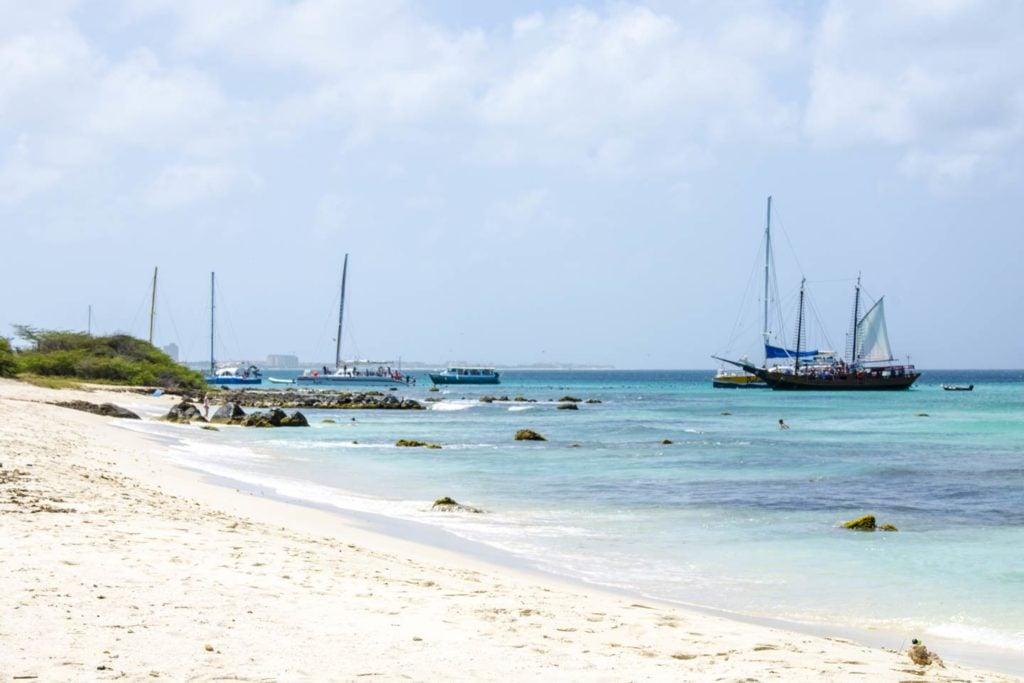Fishing boats in the water near Aruba's Malmok Beach.
