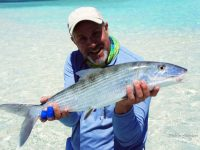 An angler holding a Bonefish he caught while fishing the flats in the Bahamas