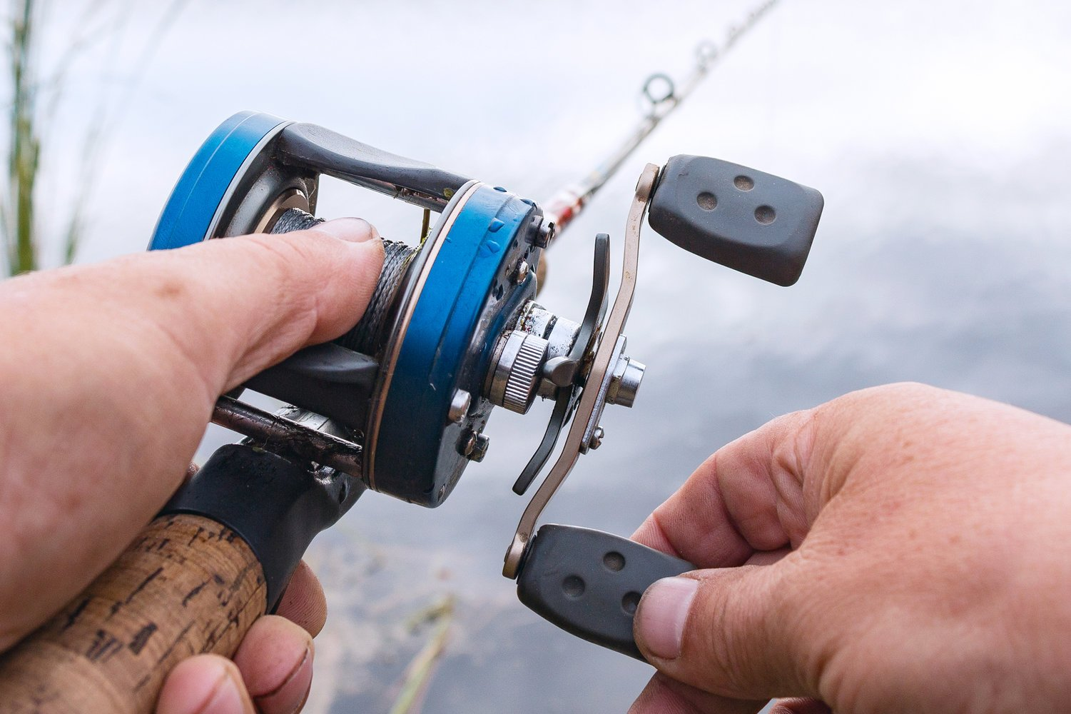a closeup of a baitcaster, the most advanced type of fishing reel