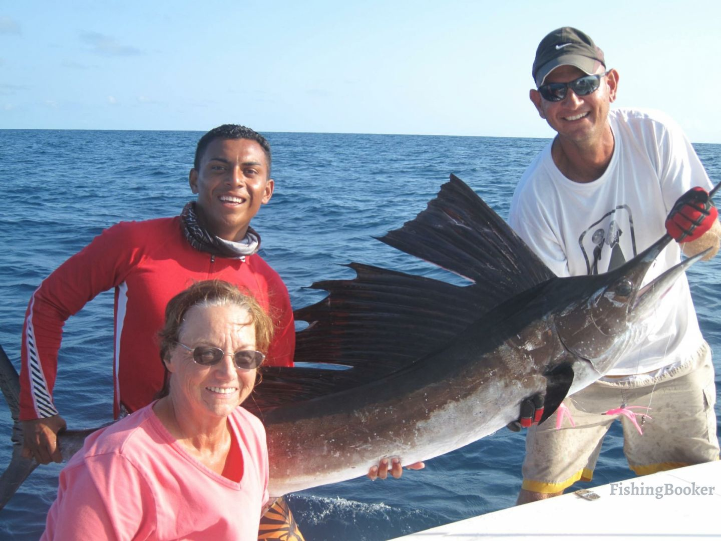 Big game fishing in Belize: Anglers holding a Sailfish