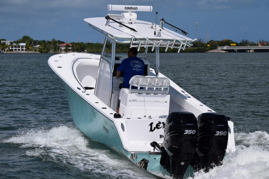 a high speed center console fishing boat in the water