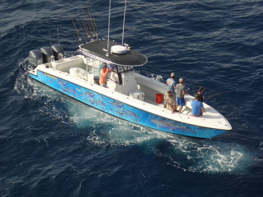an aerial view of a fishing boat and the anglers on it