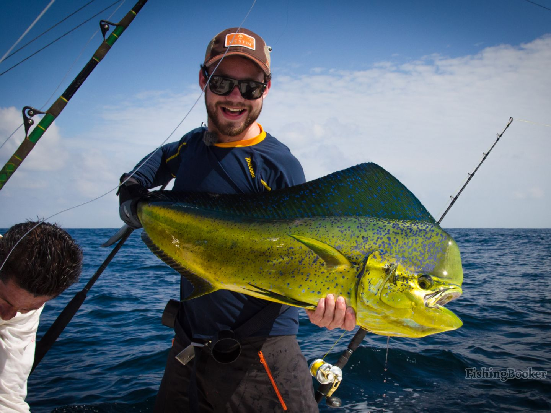 Cancun fishing: A smiling angler holding a big Dorado