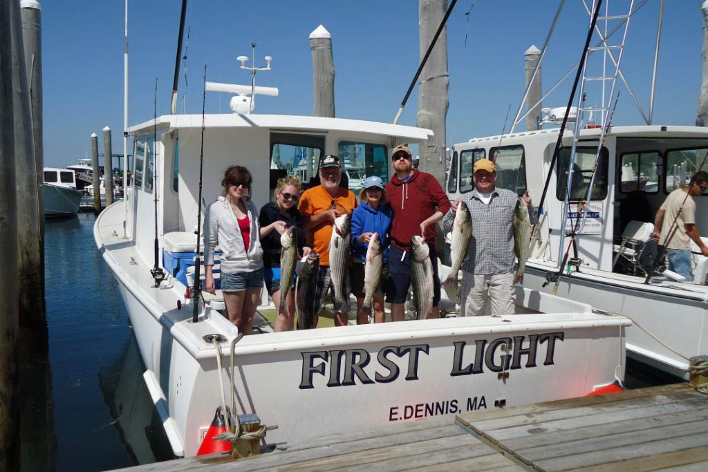 A group of anglers returning to the dock in Dennis, Massachusetts, having aught some Striped Bass