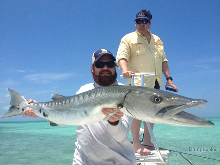 An angler holding a Barracuda he caught while fishing the channels of Cudjoe Key.