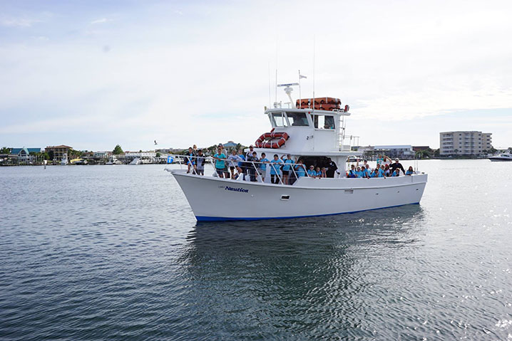A big Destin party boat taking anglers to fish in the Gulf of Mexico