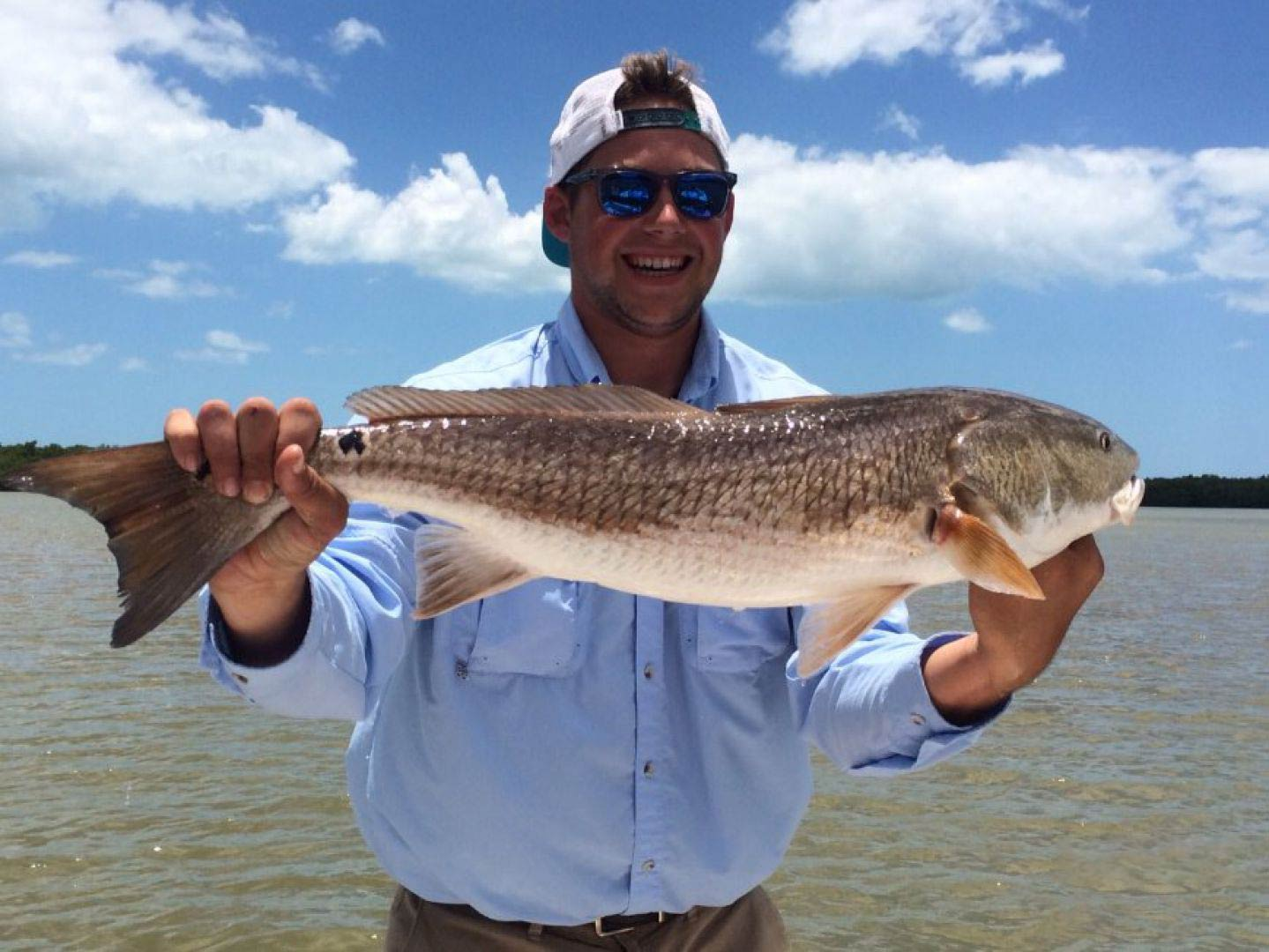 A man holding a Redfish in the Everglades, Florida