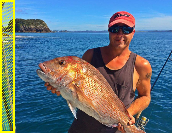 The photo showing an angler holding pink snapper with an example of bad photo composition