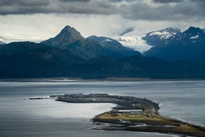 An aerial view of Alaska's Homer Spit, with mountains in the distance