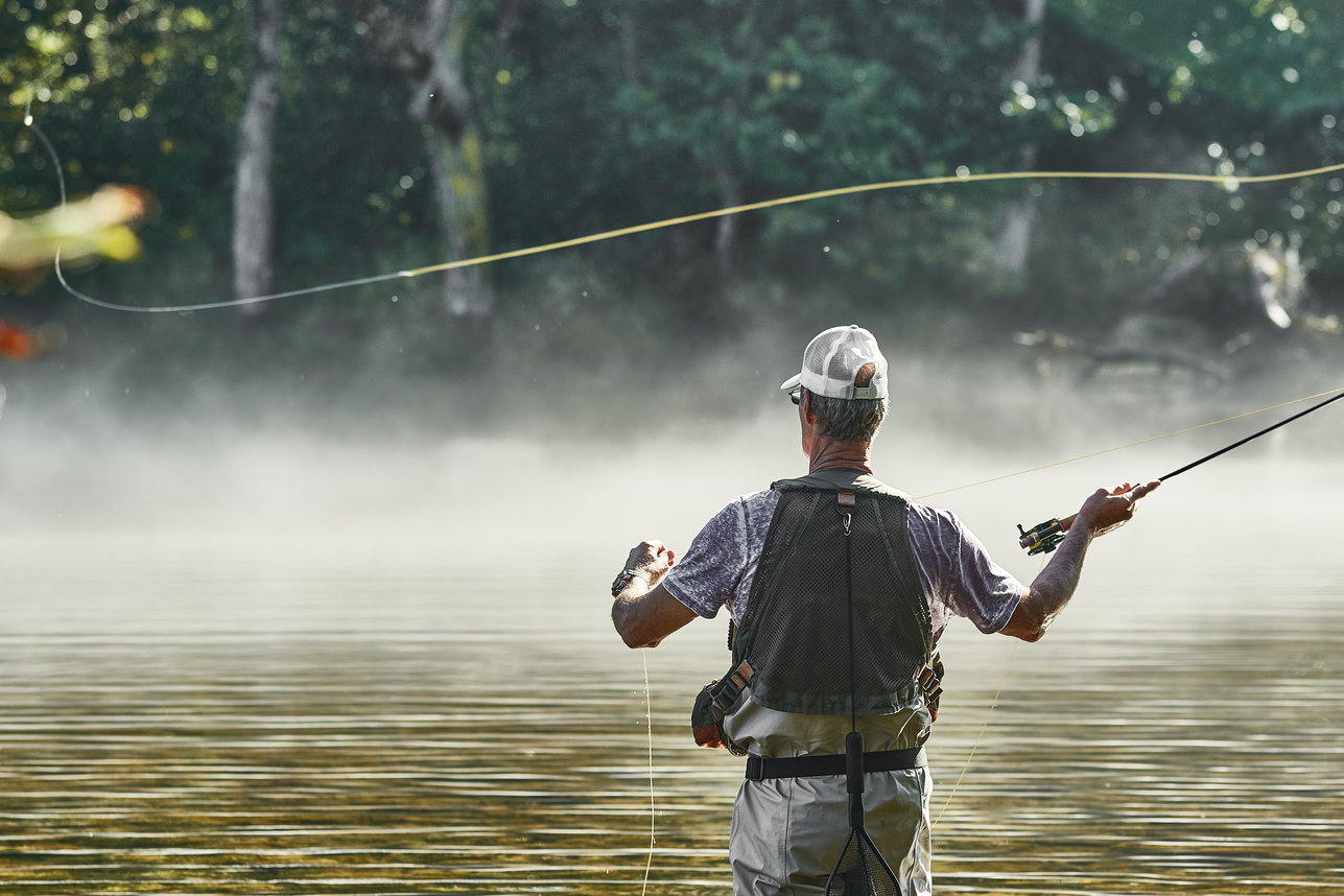 a fly fisherman casting in a Tennessee river