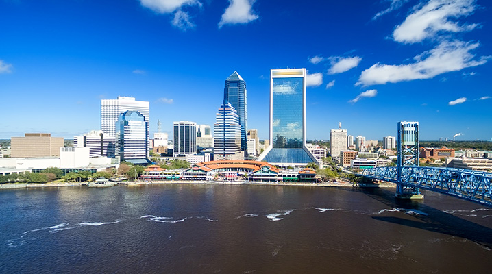 The image of Jacksonville cityscape showing the river and skyscrapers