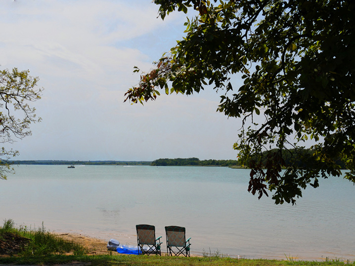 View of a picnic spot, trees, and the waters of Lake Murray.
