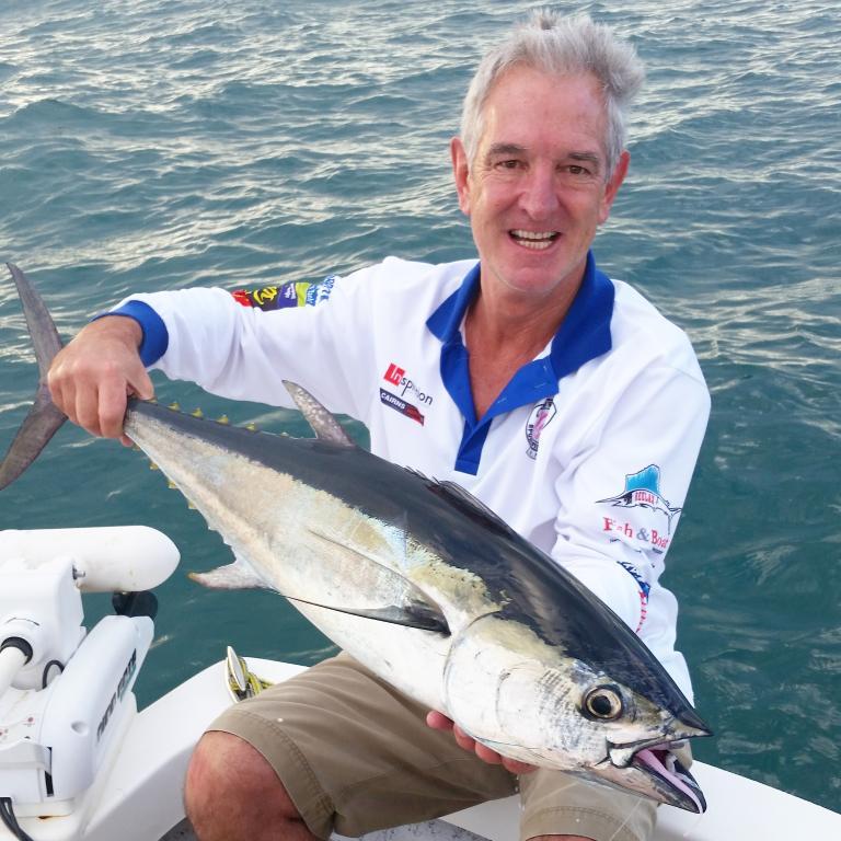 An angler holding a Longtail Tuna