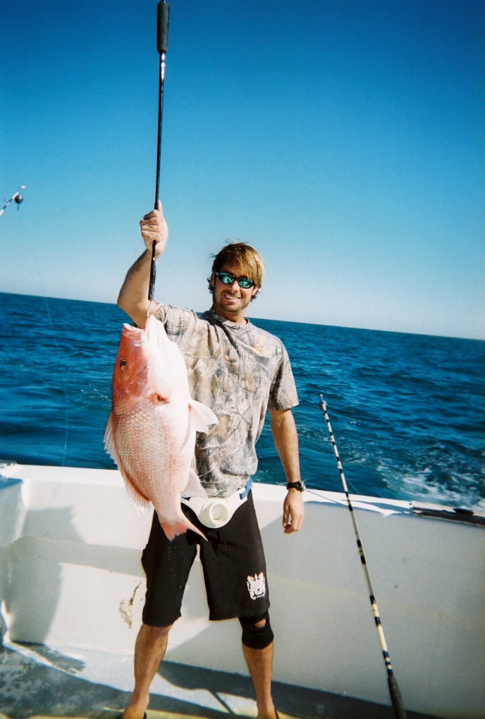 Destin Fishing Rodeo: An angler holding a Red Snapper