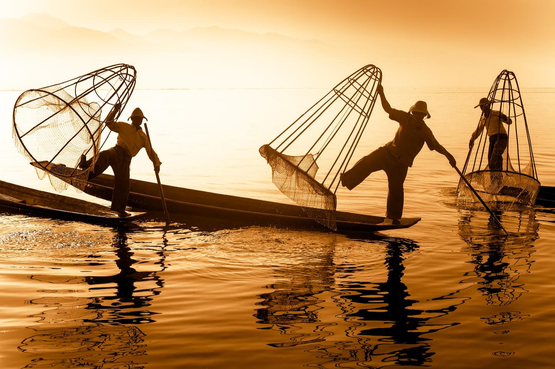 Vietnamese fishermen using nets to catch fish