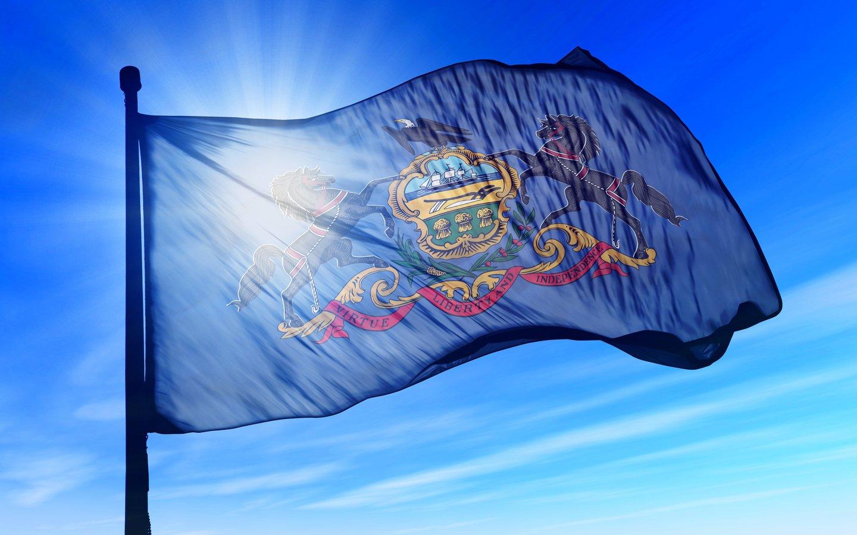 pennsylvania state flag against the sun