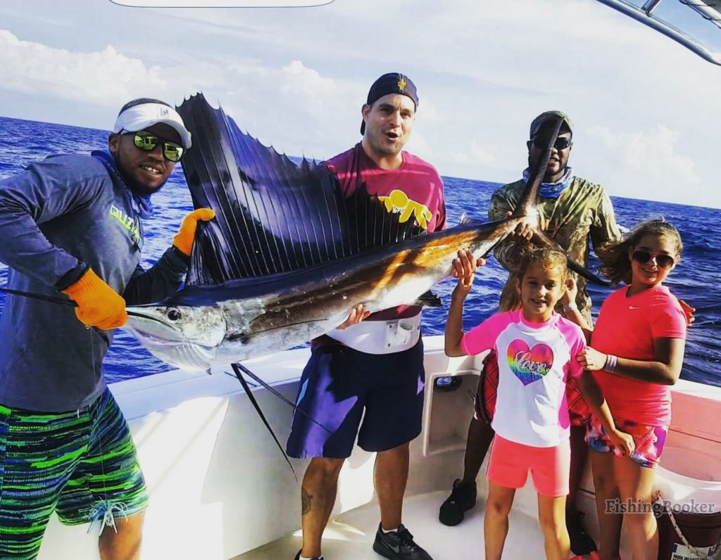 A group of anglers holding a Sailfish on a Punta Cana fishing trip