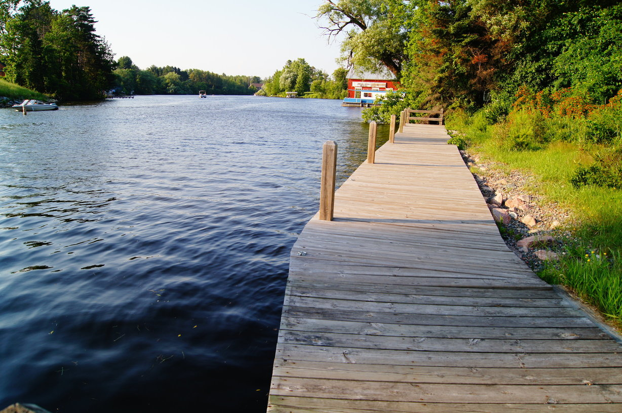 A boardwalk next to a body of water in the Eagle River System, one of Wisconsin's best fishing spots